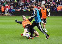 Wednesday, 23 April 2014<br /> Pictured L-R:Jordi Amat tackling Jose Canas. <br /> Re: Swansea City FC are holding an open training session for their supporters at the Liberty Stadium, south Wales,