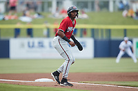 Joe Gray Jr. (5) of the Carolina Mudcats takes his lead off of third base against the Kannapolis Cannon Ballers at Atrium Health Ballpark on June 9, 2021 in Kannapolis, North Carolina. (Brian Westerholt/Four Seam Images)
