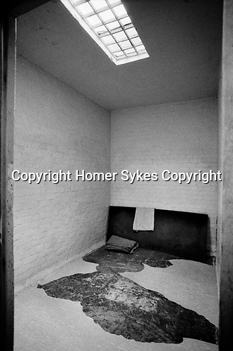 Prison cell UK 1980s. Punishment block solitary confinement, flooring has been ripped up in goal at HM Prison Styal Wilmslow Cheshire 1986.