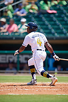 Montgomery Biscuits right fielder Justin Williams (4) follows through on a swing during a game against the Mississippi Braves on April 25, 2017 at Montgomery Riverwalk Stadium in Montgomery, Alabama.  Mississippi defeated Montgomery 3-2.  (Mike Janes/Four Seam Images)