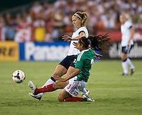 Lauren Holiday (12) of the USWNT is tackled by Bianca Sierra (3) of Mexico during an international friendly at RFK Stadium in Washington, DC.  The USWNT defeated Mexico, 7-0.