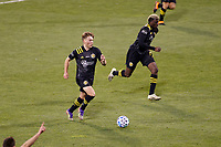 COLUMBUS, OH - DECEMBER 12: Aidan Morris #21 and Gyasi Zardes #11 of Columbus Crew in action against Seattle Sounders FC during a game between Seattle Sounders FC and Columbus Crew at MAPFRE Stadium on December 12, 2020 in Columbus, Ohio.