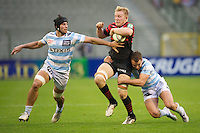 20121020 Copyright onEdition 2012©.Free for editorial use image, please credit: onEdition..Jackson Wray of Saracens is tackled by Olly Barkley (right) and Antoine Battut of Racing Metro 92 during the Heineken Cup Round 2 match between Saracens and Racing Metro 92 at the King Baudouin Stadium, Brussels on Saturday 20th October 2012 (Photo by Rob Munro)..For press contacts contact: Sam Feasey at brandRapport on M: +44 (0)7717 757114 E: SFeasey@brand-rapport.com..If you require a higher resolution image or you have any other onEdition photographic enquiries, please contact onEdition on 0845 900 2 900 or email info@onEdition.com.This image is copyright the onEdition 2012©..This image has been supplied by onEdition and must be credited onEdition. The author is asserting his full Moral rights in relation to the publication of this image. Rights for onward transmission of any image or file is not granted or implied. Changing or deleting Copyright information is illegal as specified in the Copyright, Design and Patents Act 1988. If you are in any way unsure of your right to publish this image please contact onEdition on 0845 900 2 900 or email info@onEdition.com