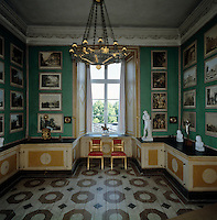 Carl XIII's study, also know as the Green Cabinet, was decorated as a print room by pasting a collection of coloured engravings directly onto the walls