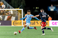 FOXBOROUGH, MA - SEPTEMBER 11: Nicolas Acevedo #26 of New York City FC passes the ball as Tommy McNamara #26 of New England Revolution closes during a game between New York City FC and New England Revolution at Gillette Stadium on September 11, 2021 in Foxborough, Massachusetts.