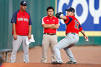 """July 28, 2009:  Starting Pitcher Junichi Tazawa of the Pawtucket Red Sox delivers a pitch in the bullpen as his interpreter and pitching coach Rich Sauver watch before a game at Coca-Cola Field in Buffalo, NY.  Tazawa was signed out of Japan and making his """"AAA"""" debut with Pawtucket, the International League Triple-A affiliate of the Boston Red Sox.  Photo By Mike Janes/Four Seam Images"""