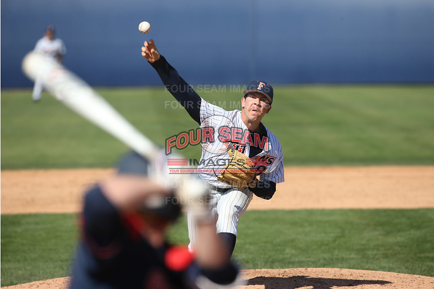 Brett Conine (18) of the Cal State Fullerton Titans pitches against the Gonzaga Bulldogs at Goodwin Field on March 12, 2017 in Fullerton, California. Fullerton defeated Gonzaga, 3-2. (Larry Goren/Four Seam Images)