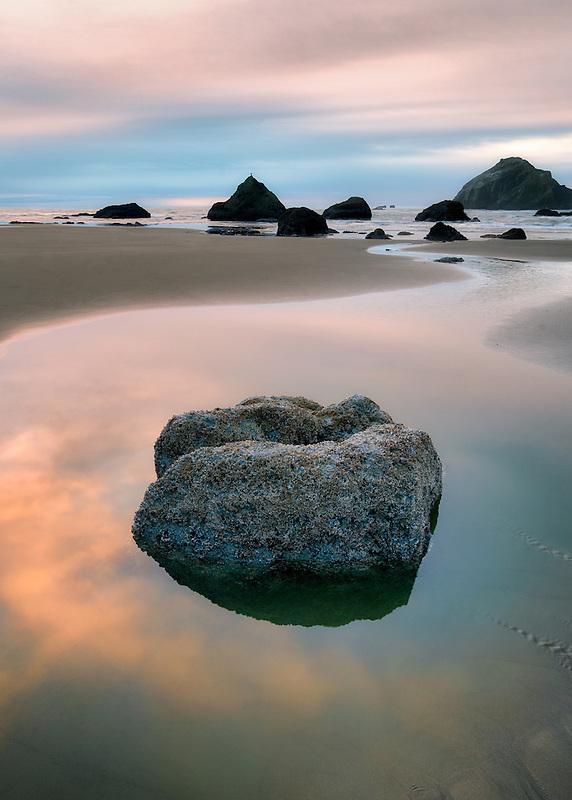 Low tide pool and sunset. Bandon, Oregon.