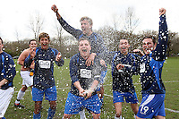 East Moore FC players celebrate the promotion to the top division of the East London Sunday League with champagne at Hackney Marshes - 29/03/09 - MANDATORY CREDIT: Gavin Ellis/TGSPHOTO - Self billing applies where appropriate - Tel: 0845 094 6026