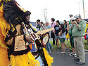 Tourist photographs Spy Boy Keith of the Wild Tchoupitoulas, Super Sunday Mardi Gras, 2013