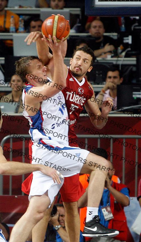 Hidayet TURKOGLU (Turkey) blocks Dusko SAVANOVIC (Serbia) during the semi-final World championship basketball match against Serbia in Istanbul, Serbia-Turkey, Turkey on Saturday, Sep. 11, 2010. (Novak Djurovic/Starsportphoto.com) .