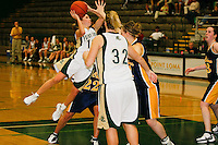 Senior Katie Hilbelink of Point Loma Nazarene University is airborne as she shoots over defenders from UW Eau Claire during the 2007 Surf N Slam Women?s Basketball Tournament at Golden Gymnasium on the PLNU campus in San Diego, Saturday December 29 2007. Hilbelink and fellow senior Kerra Sutton-Wodarski contributed 13 points each to the Sea Lions  71 - 51 victory over Eau Claire that secured fourth place overall in the Surf N Slam.  Hilbelink was selected for the all-tournament team.  PLNU played host to the tournament December 27, 28 and 29.  The eight team field included seven NCAA DIII schools; UW Stevens Point, UW Eau Claire, Carroll (WI), Gustavus Adolphus (MN), Ithaca (NY), Maryville (MO), Rivier (NH). Point Loma was the only NAIA school competing.  The tournament was won by Maryville who defeated Gustavus Aldolphus 68-64 in the final game on Saturday.