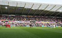 Watford and Swansea players huddle before kick off during the Premier League match between Swansea City and Watford at The Liberty Stadium, Swansea, Wales, UK. Saturday 23 September 2017