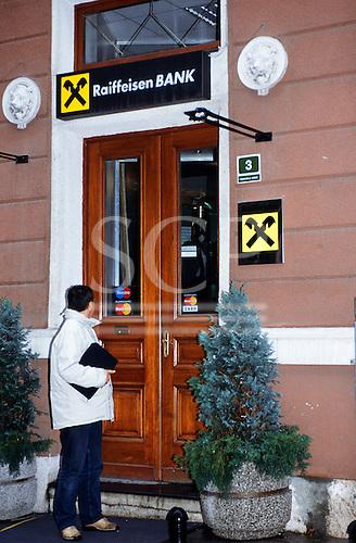Sarajevo, Bosnia and Herzegovina. The entrance of the Raiffeisen Bank; man; Master Card sign.