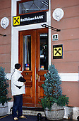 Sarajevo, Bosnia and Herzegovina. The entrance of the Raiffeisen Bank; man; Master Card sign.