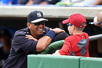 New York Yankees third baseman Alex Rodriguez (13) talks with a young fan before a Spring Training game against the Philadelphia Phillies on March 27, 2015 at Bright House Field in Clearwater, Florida.  New York defeated Philadelphia 10-0.  (Mike Janes/Four Seam Images)