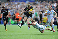 Chris Ashton of Saracens tries to escape from the clutches of  Matt Jess of Exeter Chiefs