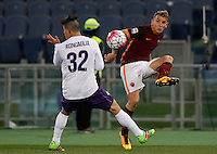 Calcio, Serie A: Roma vs Fiorentina. Roma, stadio Olimpico, 4 marzo 2016.<br /> Roma's Lucas Digne, right, is challenged by Fiorentina's Facundo Roncaglia during the Italian Serie A football match between Roma and Fiorentina at Rome's Olympic stadium, 4 March 2016.<br /> UPDATE IMAGES PRESS/Riccardo De Luca
