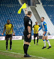 19th December 2020 The John Smiths Stadium, Huddersfield, Yorkshire, England; English Football League Championship Football, Huddersfield Town versus Watford; Jeremy Ngakia of Watford argues with linesman