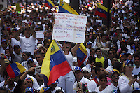 Venezuela: Caracas,18/02/14 <br /> A woman hold a banner against Maduro and Castro Brothers during the rally in support of Leopoldo Lopez, in Plaza Brion in Chacaito, Caracas. Lopez was then handed to the National Guard, because the government had issued an arrest warrant against him responsible for the violence of the protest 12F, where two students and a member of a pro-government paramilitary group died. <br /> Adolfo Acosta/Archivolatino