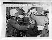 Oslo, Norway June 5, 1990: A young girl is being arrested by Norwegian riot police during an illegal demonstraion against Soviet President Gorbatchev in Oslo. Gorbachev held his Nobel peace prize speach at the Oslo City Hall.