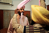 Before the wedding of British/Punjabi couple Lindsay and Navneet Singh, the groom has the turban that he will wear created.