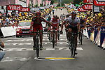 George Hincapie (USA) BMC racing Team and Edvald Boasson Hagen (NOR) Sky Procycling cross the line together at the end of Stage 12 of the 99th edition of the Tour de France 2012, running 148km from Saint-Jean-de-Maurienne to Annonay-Davezieux, France. 13th July 2012.<br /> (Photo by Thomas van Bracht/NEWSFILE)