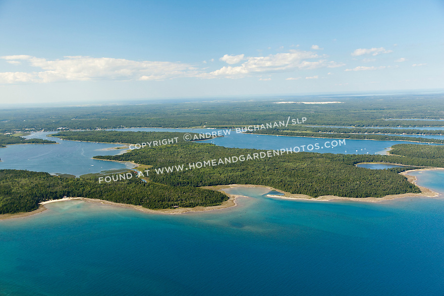 Lake Huron shoreline showing Little LaSalle and Big LaSalle Islands and Government Bay beyond (right, with boats), plus Urie and Muskie Bays (left); Les Cheneaux Area of Lake Huron shoreline near Cedarville, MI