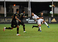 LAKE BUENA VISTA, FL - JULY 18: Brian Rodríguez #17 of LAFC stretches to play the ball while defended by Diego Rossi #9 of LAFC during a game between Los Angeles Galaxy and Los Angeles FC at ESPN Wide World of Sports on July 18, 2020 in Lake Buena Vista, Florida.