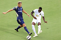 CARY, NC - AUGUST 01: Boluwatife Akinyode #3 plays the ball away from Robert Kristo #11 during a game between Birmingham Legion FC and North Carolina FC at Sahlen's Stadium at WakeMed Soccer Park on August 01, 2020 in Cary, North Carolina.