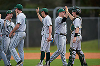 Dartmouth Big Green Max Hunter (15), Jack Metzger (29), Justin Murray (5), Michael Calamari (3), and Ben Rice celebrate closing out a game against the Omaha Mavericks on February 23, 2020 at North Charlotte Regional Park in Port Charlotte, Florida.  Dartmouth defeated Omaha 8-1.  (Mike Janes/Four Seam Images)