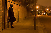 Woman in a London street at night (posed my model)