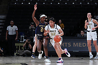 WINSTON-SALEM, NC - FEBRUARY 06: Alexandria Scruggs #32 of Wake Forest University is defended by Destinee Walker #24 of the University of Notre Dame during a game between Notre Dame and Wake Forest at Lawrence Joel Veterans Memorial Coliseum on February 06, 2020 in Winston-Salem, North Carolina.