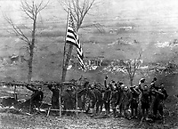 One of the guns of Battery D, 105th Field Artillery, showing American flag which was hoisted after the last shot had been fired when the armistice work effect. Etraye, France.  November 11, 1918.  Sfc. Morris Fineberg.  (Army)<br />NARA FILE #:  111-SC-33075<br />WAR & CONFLICT BOOK #:  712
