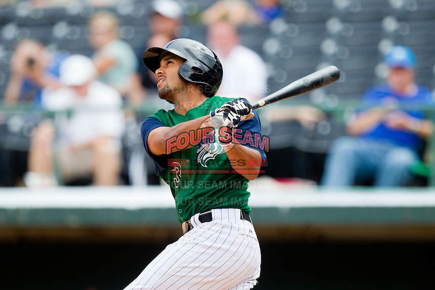 Marcus Semien (3) of the Charlotte Knights follows through on his swing against the Durham Bulls at Knights Stadium on August 18, 2013 in Fort Mill, South Carolina.  The Bulls defeated the Knights 8-5 in Game One of a double-header.  (Brian Westerholt/Four Seam Images)