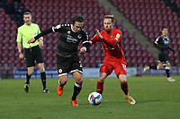 Sam Matthews of Crawley Town and James Brophy of Leyton Orient during Leyton Orient vs Crawley Town, Sky Bet EFL League 2 Football at The Breyer Group Stadium on 19th December 2020