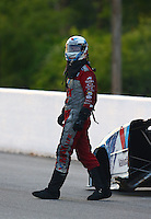 May 17, 2014; Commerce, GA, USA; NHRA funny car driver Jack Beckman climbs from his car after exploding an engine during qualifying for the Southern Nationals at Atlanta Dragway. Beckman was unhurt in the explosion. Mandatory Credit: Mark J. Rebilas-USA TODAY Sports