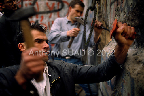 West Berlin, West Germany<br /> November 11, 1989<br /> <br /> A group of West Germans break through the wall near the Brandenburg Gate. The East German government lifts travel and emigration restrictions to the West on November 9, 1989.