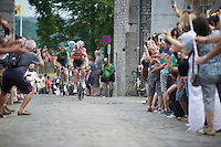 the breakaway group led by Thomas De Gendt (BEL/Lotto-Soudal) crosses the narrow bridge over the Citadel de Namur cobbles<br /> <br /> stage 4: Seraing (BEL) - Cambrai (FR) <br /> 2015 Tour de France