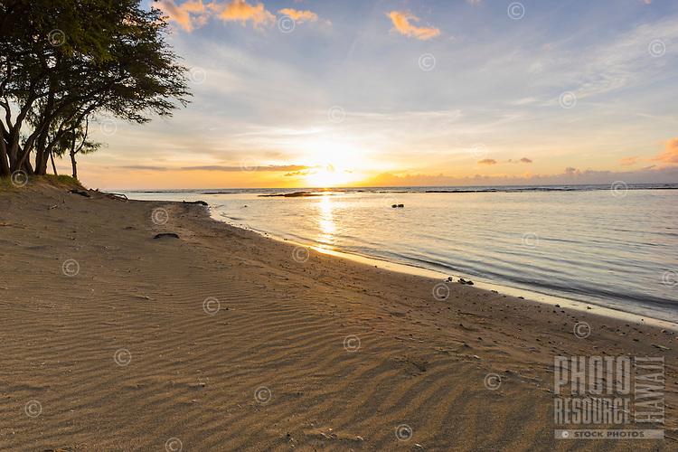 A relaxing sunset beach scene in Puako, Big Island of Hawai'i.