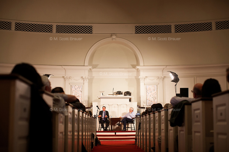 Glenn Greenwald (dark suit) and Noam Chomsky speak to an audience at the First Parish Church in Harvard Square for a Harvard Book Store author event  in Cambridge, Massachusetts, USA. The event was part of a book tour for Greenwald's recently released book, No Place to Hide: Edward Snowden, the NSA, and the U.S. Surveillance State. Chomsky is a well-known linguist, professor at MIT, and writer on political topics. Greenwald is a lawyer, blogger, writer, and journalist, known most recently for his role in the Snowden NSA leaks. Greenwald recently received a Polk Award for National Security Reporting, and the 2014 Pulitzer Prize for Public Service.
