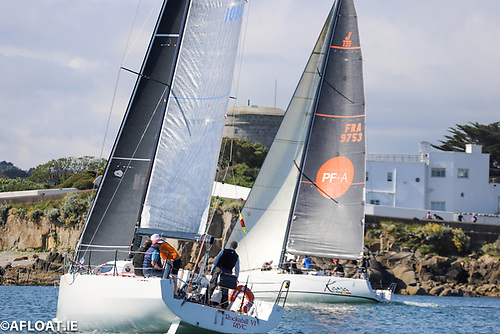 JPK 10.80 Rockabill VI (left) and J122 Kaya cross tacks on the Dublin Bay shore line at Sandycove in the early stage of yesterday's 35-mile ISORA Race Ten
