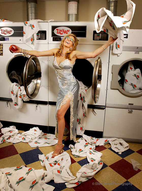 Denver, Co.  February 11, 2005.   Fashion shoot in the Nuggets' locker room at the Pepsi Center.  Peggy Vendeweghe, wife of Nuggets General Manager Kiki Vandeweghe, brings some needed glamour to the laundry room.  (Photo by ELLEN JASKOL/ROCKY MOUNTAIN NEWS)