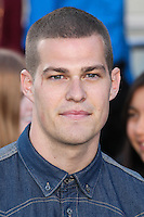 """WESTWOOD, LOS ANGELES, CA, USA - MARCH 18: Greg Finley at the World Premiere Of Summit Entertainment's """"Divergent"""" held at the Regency Bruin Theatre on March 18, 2014 in Westwood, Los Angeles, California, United States. (Photo by Xavier Collin/Celebrity Monitor)"""