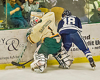 4 January 2014:  University of Vermont Catamount Goaltender Mike Santaguida, a Freshman from Mississauga, Ontario, digs the puck away from Yale University Bulldog forward Kenny Agostino, a Senior from Flanders, during the third period at Gutterson Fieldhouse in Burlington, Vermont. With an empty net and seconds remaining, the Cats came back to tie the game 3-3 against the 10th seeded Bulldogs. Mandatory Credit: Ed Wolfstein Photo *** RAW (NEF) Image File Available ***