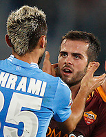Calcio, Serie A: Roma vs Napoli. Roma, stadio Olimpico, 18 ottobre 2013.<br /> AS Roma midfielder Miralem Pjanic, of Bosnia, argues with Napoli midfielder Valon Behrami, of Switzerland, left, during the Italian Serie A football match between AS Roma and Napoli at Rome's Olympic stadium, 18 October 2013.<br /> UPDATE IMAGES PRESS/Riccardo De Luca