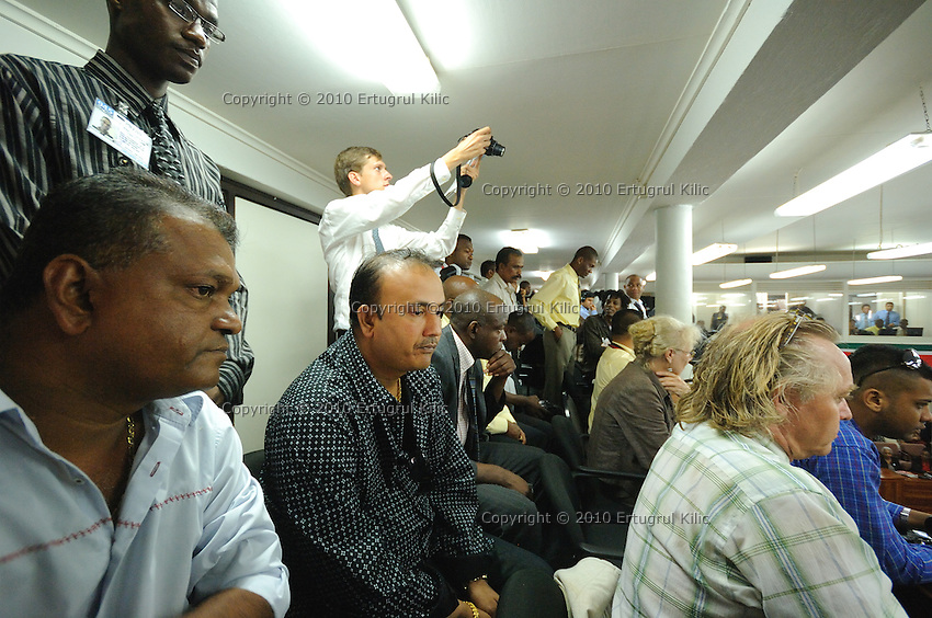 A Journalist takes photos in the middle of crowded visitors during presidential elections at De Nationale Assemblée (DNA) / The National Assemble of Suriname ..Desi Bouterse (Desiré Delano Bouterse) chosen as new president of Suriname by De Nationale Assemblée (DNA) / The National Assemble of Suriname. He took 36 votes of 51 as leader of the Mega Combination. ....Robert_Ameerali the head of KKF (Kamer van Koophandel en Fabrieken) / Chamber of Commerce and Industry also selected as Vice President.....Desi Bouterse (Desiré Delano Bouterse) will sworn at 3 August 2010