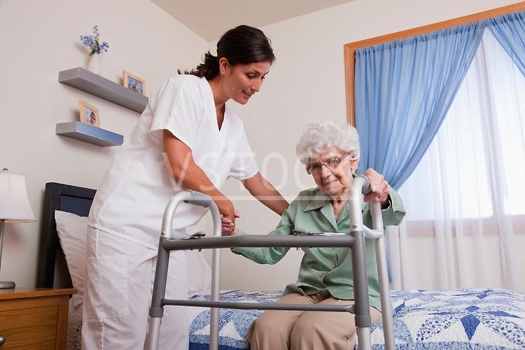 USA, Illinois, Metamora, Nurse helping senior woman with walker