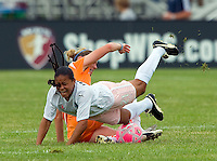 Sky Blue FC  midfielder Jen Buczkowski (4) tackles St Louis Athletica midfielder Francielle (21) during a WPS match at Anheuser-Busch Soccer Park, in St. Louis, MO, June 7, 2009. Athletica won the match 1-0.