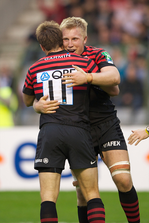 20121020 Copyright onEdition 2012©.Free for editorial use image, please credit: onEdition..Jackson Wray of Saracens (right) congratulates Chris Wyles of Saracens on scoring a try during the Heineken Cup Round 2 match between Saracens and Racing Metro 92 at the King Baudouin Stadium, Brussels on Saturday 20th October 2012 (Photo by Rob Munro)..For press contacts contact: Sam Feasey at brandRapport on M: +44 (0)7717 757114 E: SFeasey@brand-rapport.com..If you require a higher resolution image or you have any other onEdition photographic enquiries, please contact onEdition on 0845 900 2 900 or email info@onEdition.com.This image is copyright the onEdition 2012©..This image has been supplied by onEdition and must be credited onEdition. The author is asserting his full Moral rights in relation to the publication of this image. Rights for onward transmission of any image or file is not granted or implied. Changing or deleting Copyright information is illegal as specified in the Copyright, Design and Patents Act 1988. If you are in any way unsure of your right to publish this image please contact onEdition on 0845 900 2 900 or email info@onEdition.com